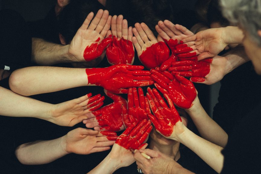Community of people with hands in heart